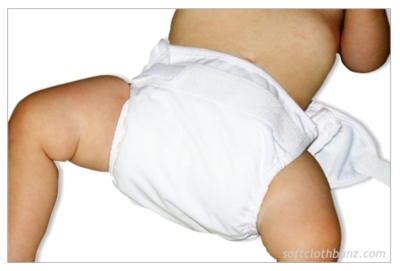 Begin folding Diaper Rite Prefold up to fit into a Bummis Super Whisper Wrap