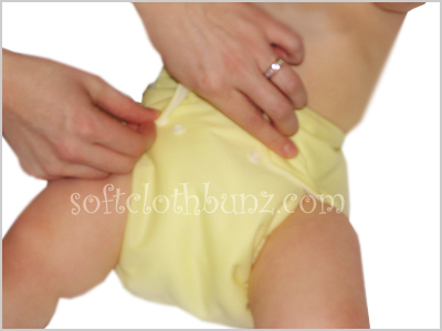 Adjusting snap settings on pocket diapers allow for a more custom fit for baby.