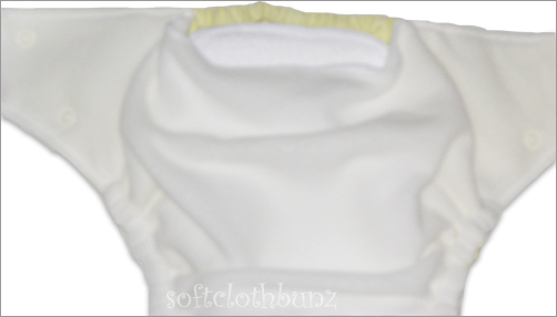 Slide the absorbent insert into the pocket opening.